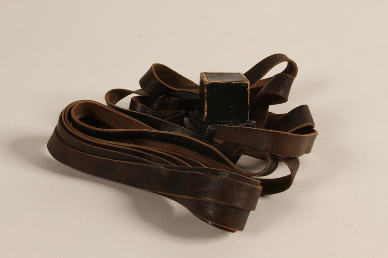 1990.223.1.2 c front Tefillin pair and embroidered pouch brought with a German Jewish refugee