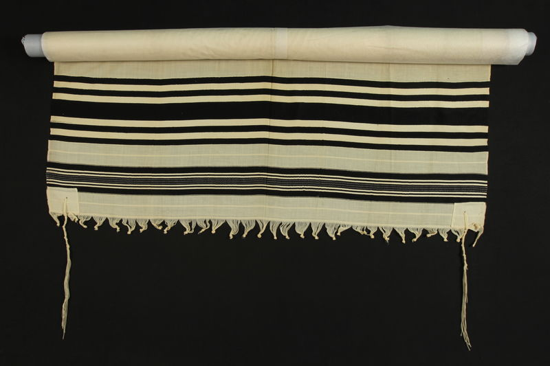 1990.223.1.3 front White wool tallit with black stripes brought with a German Jewish refugee