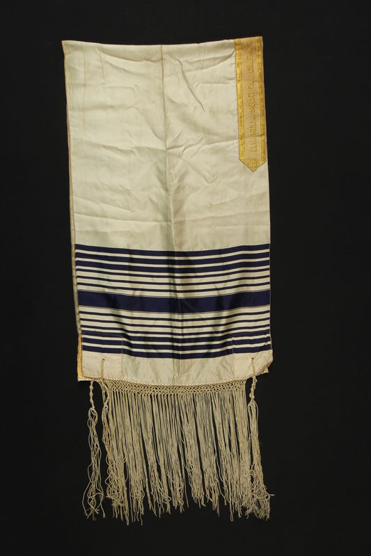 1990.223.1.4 front White silk tallit with black stripes brought with a German Jewish refugee