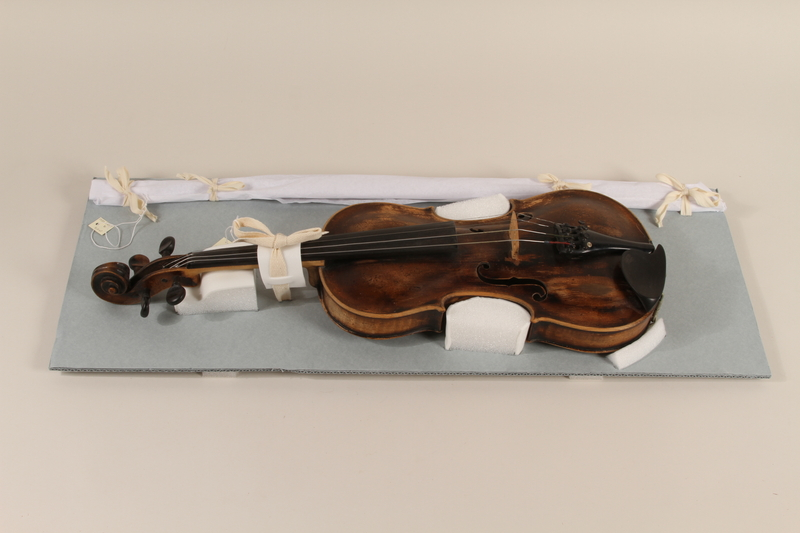 1990.225.1_a-b front Violin and case used by a Roma
