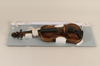 1990.225.1_a-b front Violin and case used by a Roma  Click to enlarge