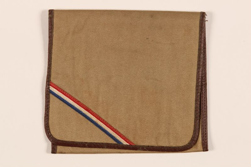 1990.23.198 front Brown cloth bag with a red, white, and blue stripe carried by a hidden Dutch Jewish woman