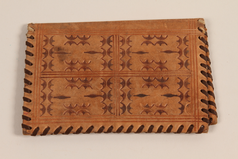 1990.23.203 front Geometric patterned leather wallet made by a Dutch Jewish couple in hiding