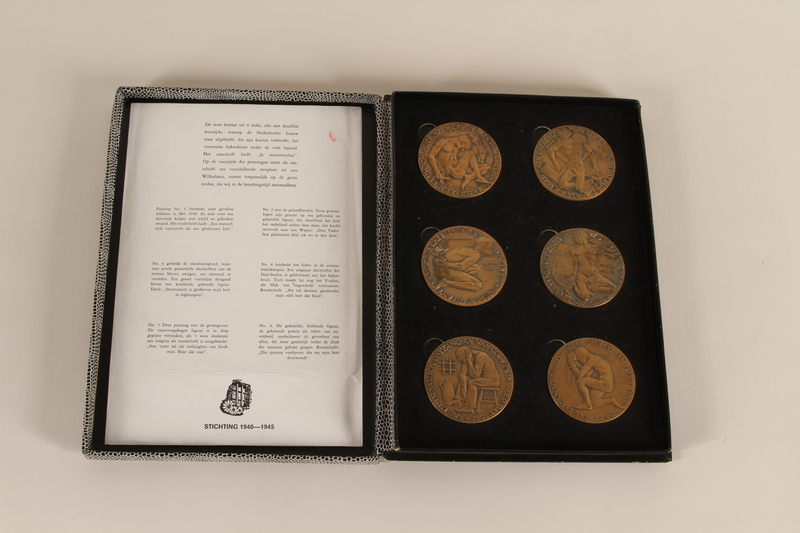 1990.23.240.1-.2 open Award certificate issued postwar with 6 medals to a Dutch resistance leader