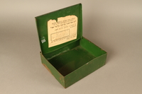 1999.333.1 3/4 open School supply metal box inscibed in Yiddish  Click to enlarge