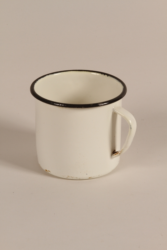 1990.230.1 front Mug used by a young Jewish man in the Riga ghetto and in hiding