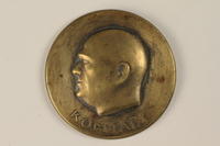 1990.245.3 front Komjadi commemorative medal owned by a Hungarian Jewish family  Click to enlarge