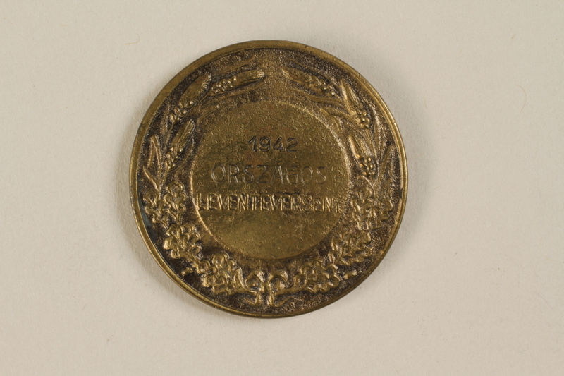 1990.245.4 back Orszagos Leventeverseny medal owned by a Hungarian Jewish family