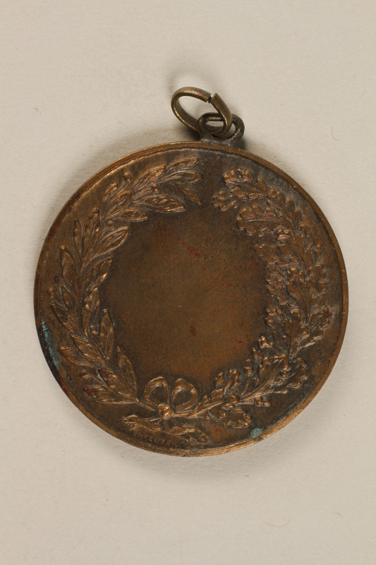 1990.245.5 back Diving medal owned by a Hungarian Jewish family