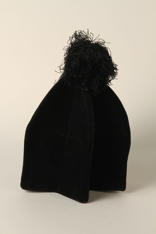 1990.245.7 front Cantor's black tufted hat worn by a Hungarian rabbi