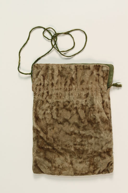 1990.245.9_a front Set of tefillin with a green pouch worn by a Hungarian rabbi