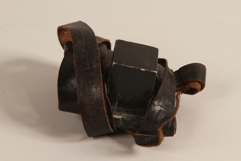 1990.245.9 b front Set of tefillin with a green pouch worn by a Hungarian rabbi