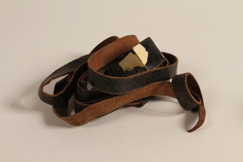 1990.245.9 c front Set of tefillin with a green pouch worn by a Hungarian rabbi