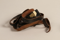 1990.245.9 c front Set of tefillin with a green pouch worn by a Hungarian rabbi  Click to enlarge