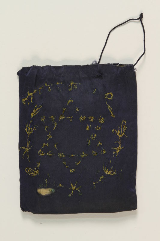 1990.251.1.1 front Embroidered blue tefillin bag carried by a Lithuanian Jewish man in hiding