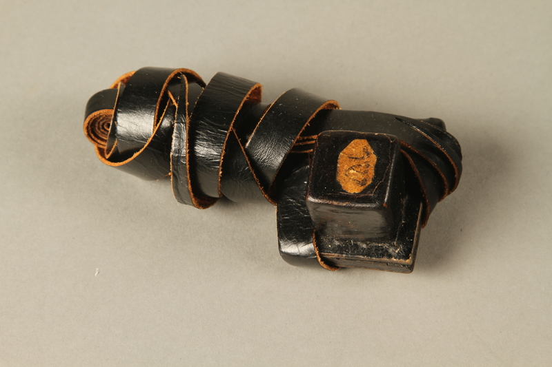 1990.251.1.3 3/4 view Tefillin worn by a Lithuanian Jewish man in hiding