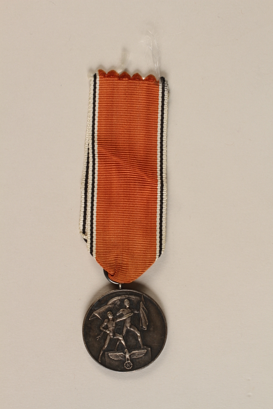 1990.252.4 front Medal and ribbon commemorating the 1938 Anschluss of Austria