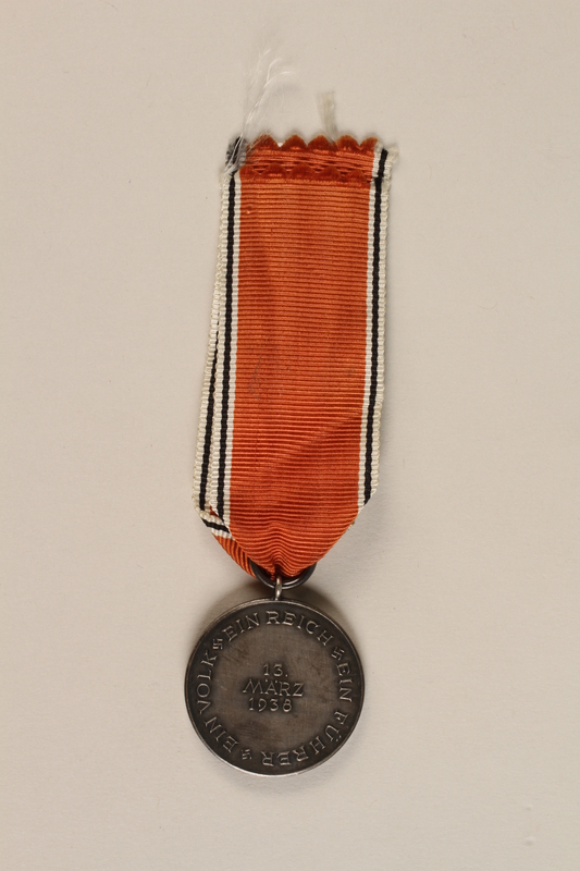 1990.252.4 back Medal and ribbon commemorating the 1938 Anschluss of Austria