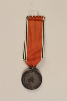 1990.252.4 back Medal and ribbon commemorating the 1938 Anschluss of Austria  Click to enlarge
