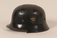1990.262.1 left side Helmet with a swastika  Click to enlarge