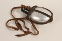 1985.1.2 front German military canteen with leather strap acquired by US soldier  Click to enlarge