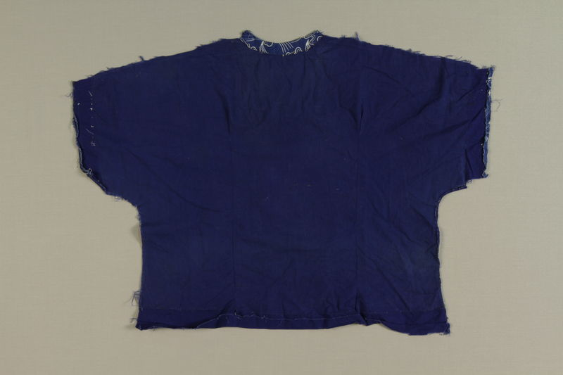 1994.71.1.3 front Partial blue cloth shirt found in a concentration camp