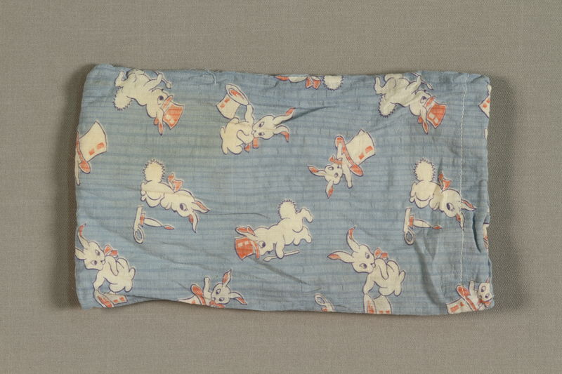 1994.71.1.4 front Cloth printed with white rabbits