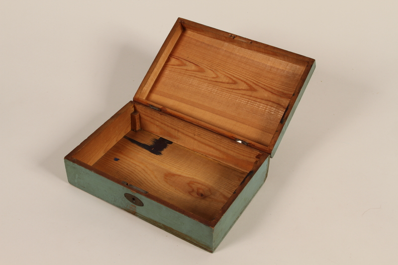 2006.492.2 open Green school box carried by a Kindertransport refugee
