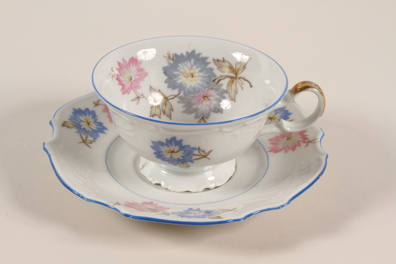 2006.492.5_a-b front Teacup and saucer with blue and pink flowers carried by Kindertransport refugee