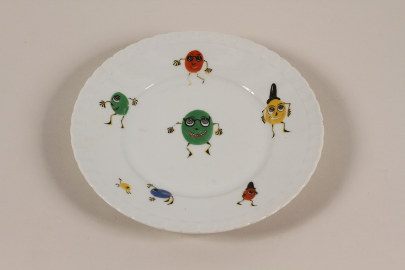 2006.492.7 front Plate with colorful, oval-shaped cartoon figures carried by a Kindertransport refugee
