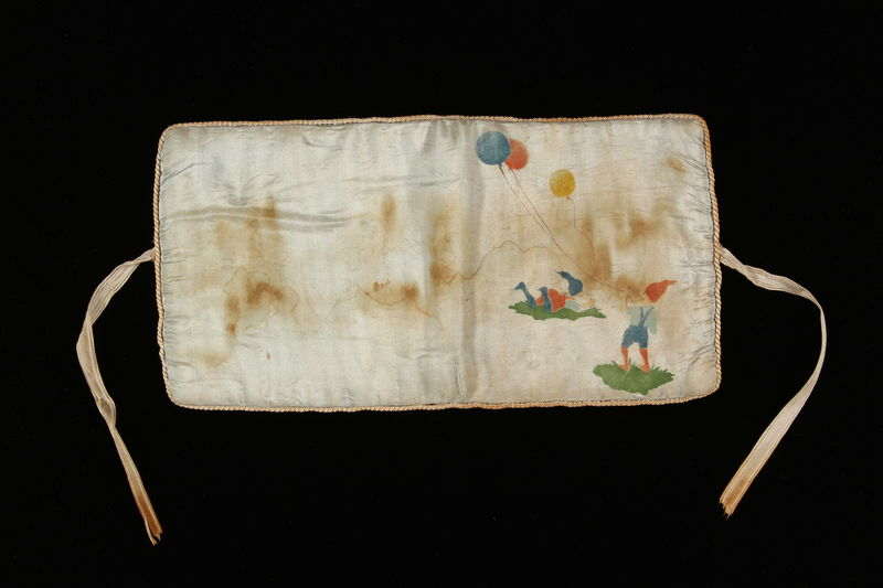 2006.492.8 front White handkerchief pouch with gnomes carried by a Kindertransport refugee