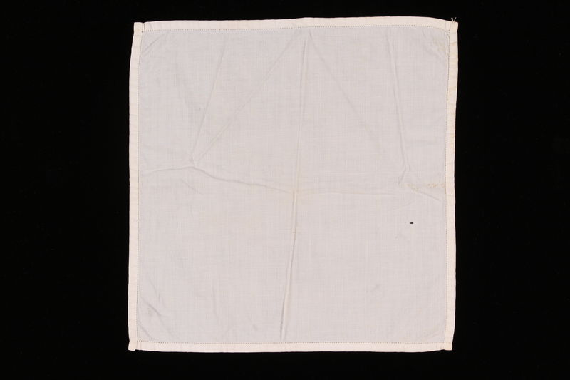 2006.492.9 front White handkerchief with a stitched border carried by a Kindertransport refugee