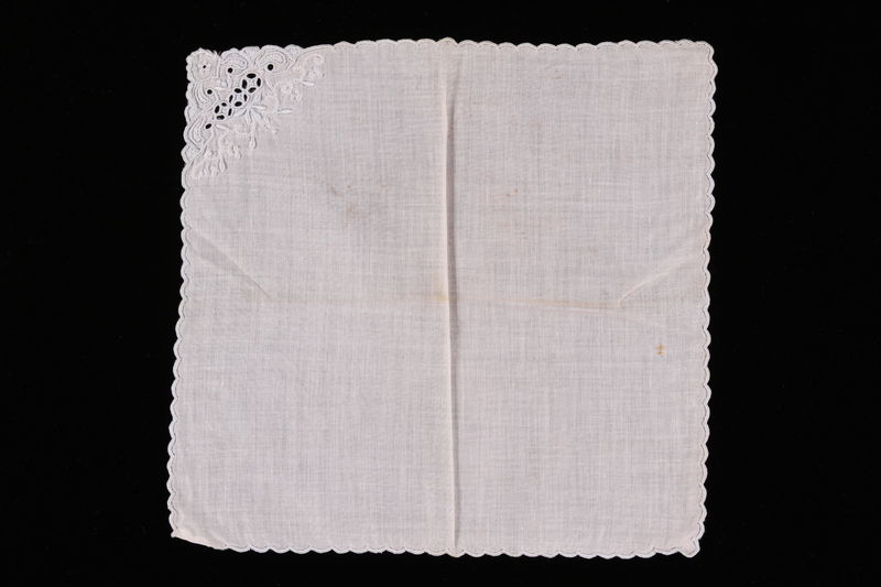 2006.492.10 front White handkerchief with openwork flowers carried by a Kindertransport refugee