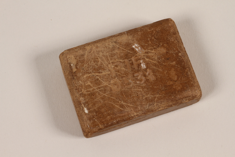 2007.469.2 front Bar of soap stamped RIF issued to an inmate of Auschwitz-Birkenau