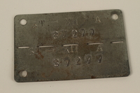 2007.475.2 front Prisoner of war identification tag issued to a Jewish American soldier in Stalag IIIC  Click to enlarge