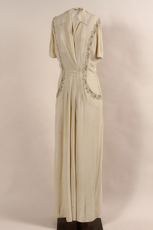 2008.393.1 front Wedding gown with silver embroidery worn by a Lithuanian Jewish woman in Barletta DP camp
