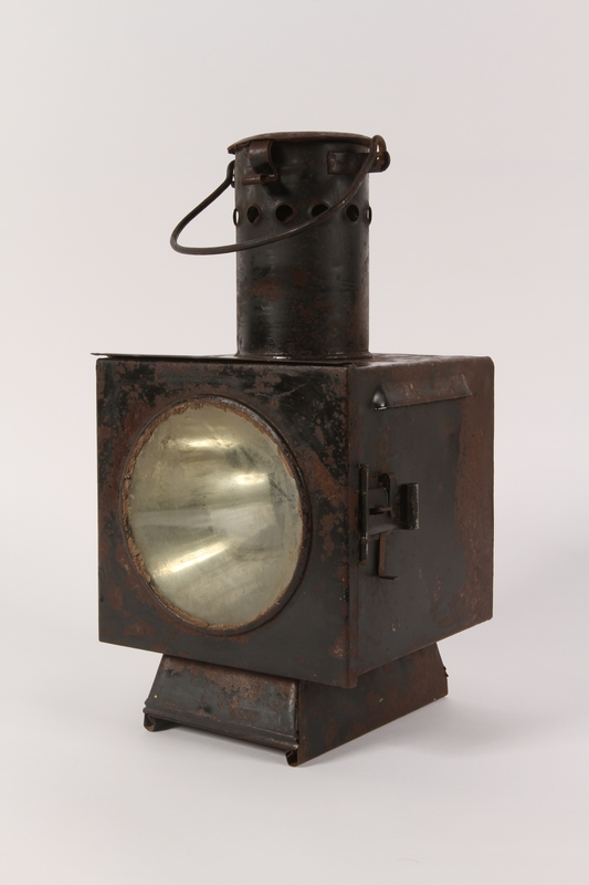 1990.291.2 front left 3/4 view Railroad signal lantern with a reflector from Sobibor railroad station