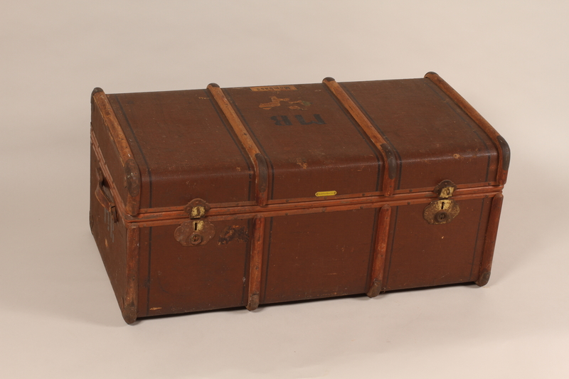 2008.199.1 front Burlap covered steamer trunk used by a German Jewish family