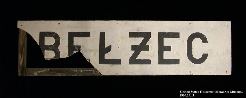 1990.291.5 front Painted composition board sign from Belzec railroad station
