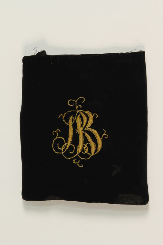 2007.471.2 front Black velvet embroidered tefillin bag buried for safekeeping while owner in hiding