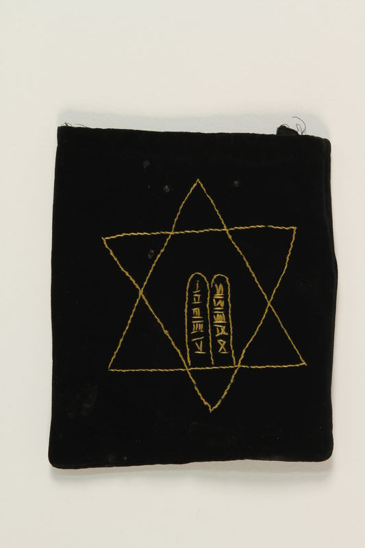 2007.471.2 back Black velvet embroidered tefillin bag buried for safekeeping while owner in hiding