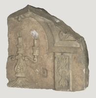 Desecrated, broken tombstone with carved candelabra from Turek Jewish cemetery  Click to enlarge