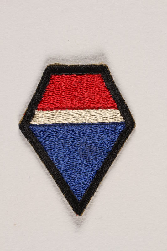 2004.748.4 front 12th Army Group red, white, and blue trapezoidal shoulder patch