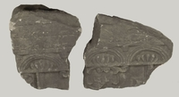 Desecrated tombstone in 2 sections with carved scrollwork from Turek Jewish cemetery  Click to enlarge