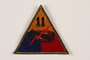US Army 11th Armored Division shoulder sleeve patch with tank tracks, gun, and red lightning bolt