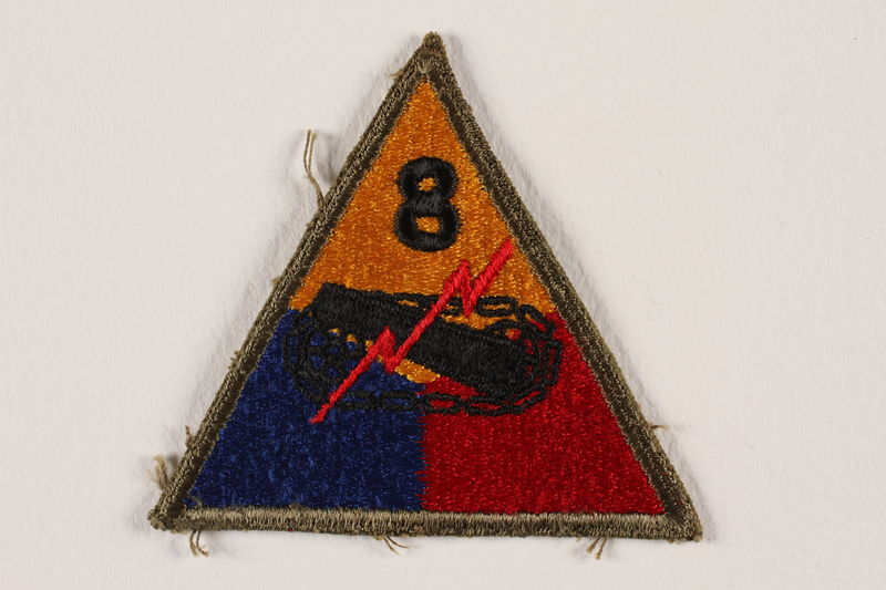2004.749.4 front US Army 8th Armored Division shoulder sleeve patch with tank, gun, and red lightning bolt