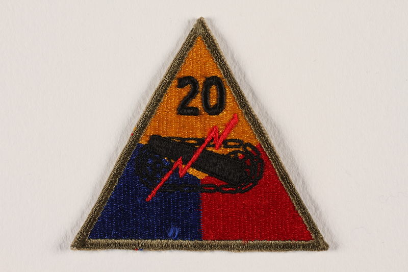 2004.749.9 front US Army 20th Armored Division shoulder sleeve patch with tank, gun, and red lightning bolt