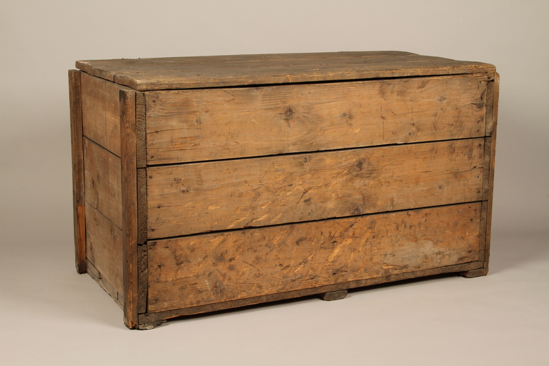 1990.296.1 3/4 view Large wooden crate used by Zegota, a Polish underground group, to hide false documents