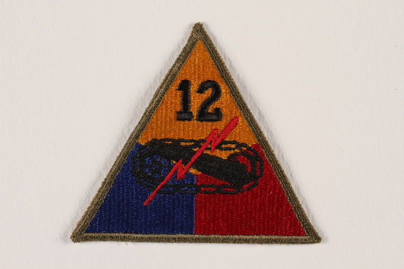 2004.749.10 front US Army 12th Armored Division shoulder sleeve patch with tank, gun, and red lightning bolt