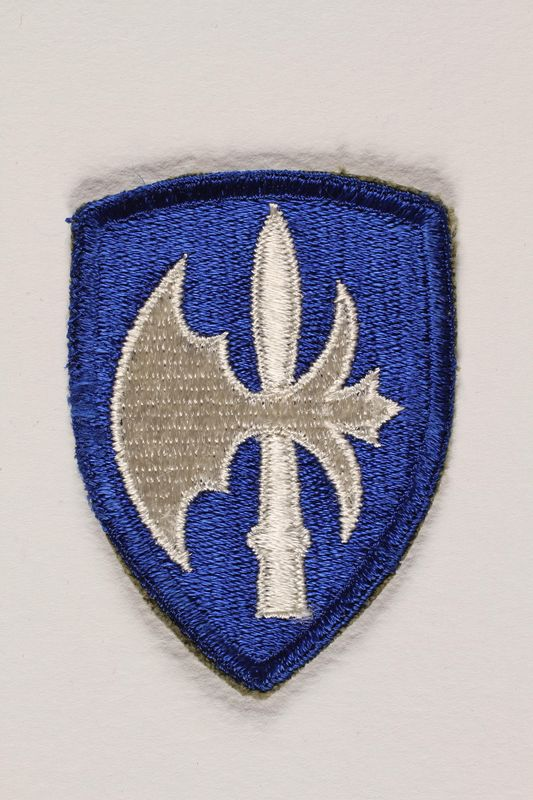 2004.749.17 front US Army 65th Infantry Division shoulder sleeve patch with a white halberd on a blue field